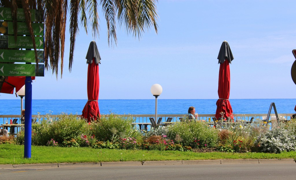 Menton seaside... love the flowers and the tables and chairs- perfect place to relax and have a good chat and a drink:)