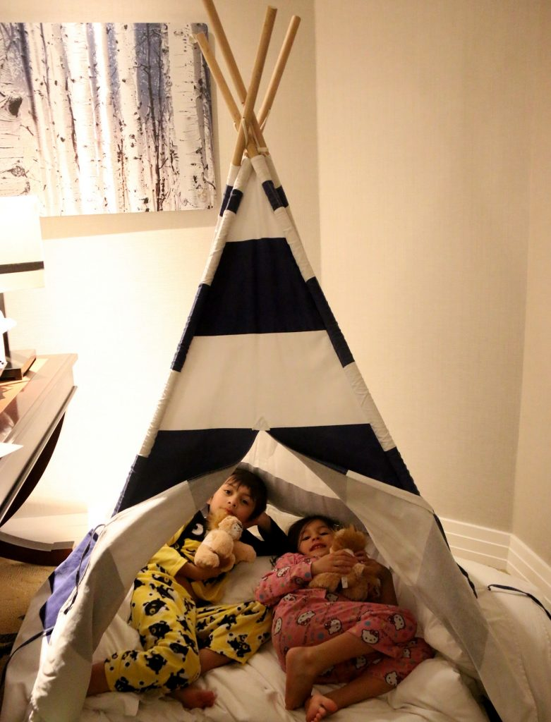 Sleeping in this fabulous Teepee... My husband moved them to their bed later that night.